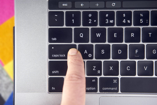 working on the laptop , work on the notebook Women or man finger click caps lock button on keyboard , Working concept