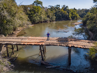 Aerial view of a rickety wooden bridge in the wilderness of Paraguay.