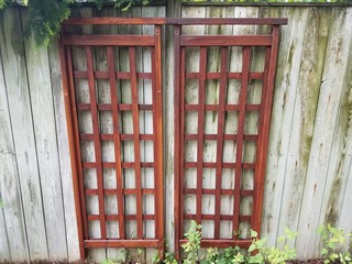 brown wood trellis or lattice on wood fence