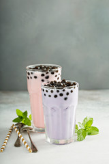 Taro and strawberry milk bubble tea in tall glasses