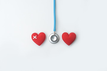 Red heart with stethoscope isolated on white backgroun