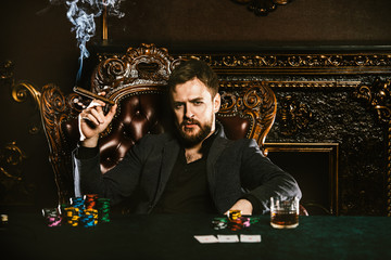 wealthy man playing poker
