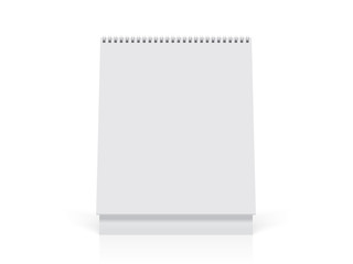 A paper white calendar stands on the table
