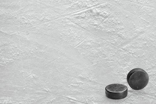 Two ice hockey washers on ice ground