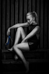 sexy blonde woman in short black dress