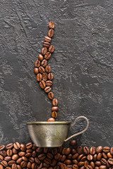 coffee beans and mug on gray concrete background