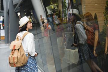 joyful woman shopping with backpack