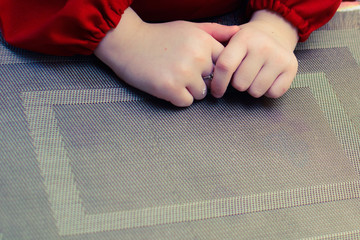 hands of the child cook on the texture substrate