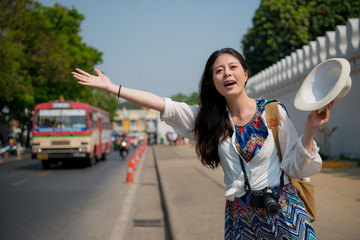 woman waving her hands to get on the tuk-tuk