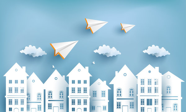 paper airplanes flying across village. design paper art and crafts
