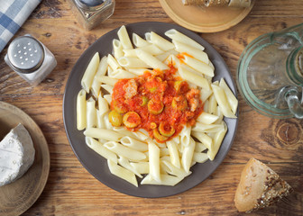 homemade stew of macaroni with tomato olive and pickle