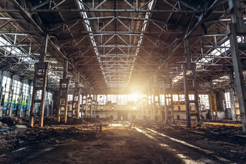 Abandoned ruined industrial factory building, corridor view with perspective and sunlight, ruins and demolition concept