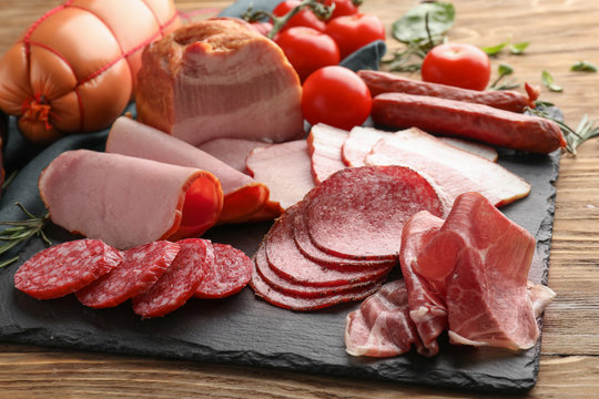 Assortment of delicious deli meats on slate plate