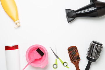 Photo of accessories of hairdresser, hair dryer, combs, bands located on clean white background.