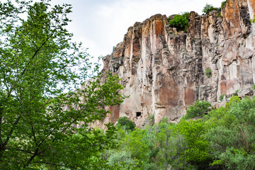 rocky wall of gorge of Ihlara Valley in Cappadocia