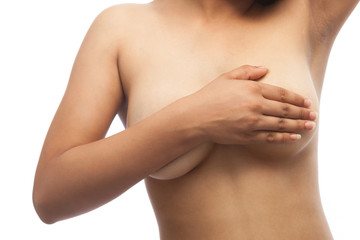An Asian woman is performing self examination of Breast Cancer. Concept of Breast Cancer, Breast care.