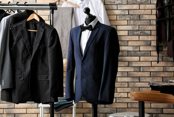 Mannequin with custom tailored jacket and shirt in atelier