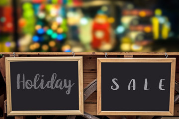 Christmas decoration, with tree and blackboard on wooden floor as a background for your message to holiday Sale or Christmas and celebration time.