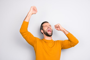 People leadership wonderment concept. Portrait of cheerful excited joyful careless handsome attractive delightful yelling shouting guy isolated on gray background