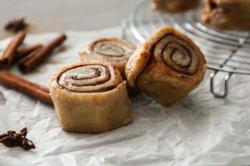 Tasty cinnamon buns on table