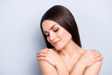 Hydration procedure rejuvenation enhancement ayurveda treatment therapy wellness wellbeing concept, attractive woman holding crossed hands on shoulders feeling good isolated on grey background