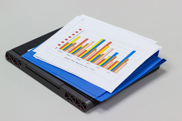 a paper sheet chart and laptop for preparation for business on the table in the meeting room, concept business office expenses.