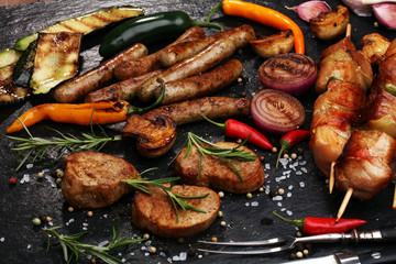 Aluminium Prints Grill / Barbecue Assorted delicious grilled meat with vegetable on a barbecue