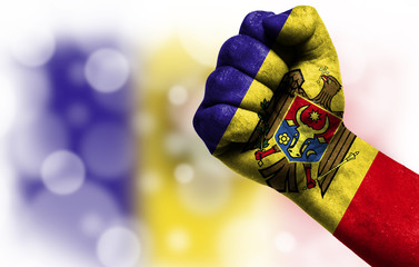 Flag of Moldova painted on male fist, concept of conflict