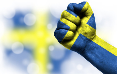 Flag of Sweden painted on male fist