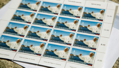 Limited edition stamps to commemorate Pope Francis' upcoming visit to Switzerland is sold at a post office in Zurich