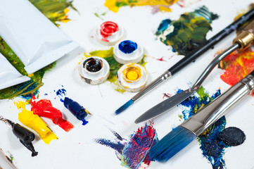 colourfull oil paints. brushes and palette knife.