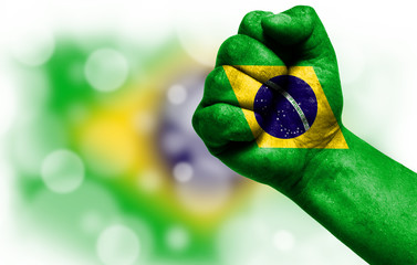 Flag of Brazil painted on male fist