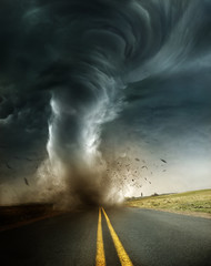A powerful supercell storm producing a destructive tornado touching down on an isolated country road. Mixed media illustration.