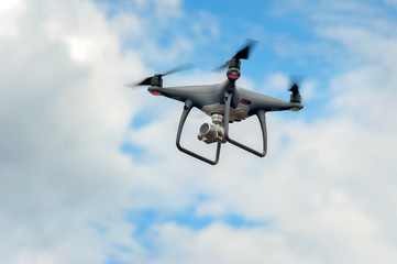drone with build-in camera at cloudly sky