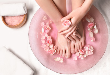 Wall Murals Pedicure Young woman undergoing spa pedicure treatment in beauty salon
