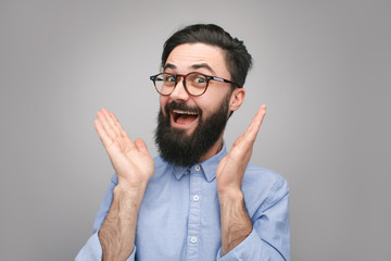 Excited hipster in surprise