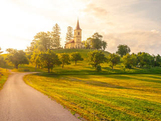 Small church in the middle of lush green spring landscape on sunny day. St. Peter and Pauls church at Bysicky near Lazne Belohrad, Czech Republic. Wall mural