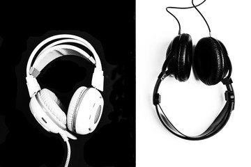 Black and white headphones on black and white backgrounds. The concept of contrast.