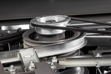 Part of a harvester engine with belt transmission