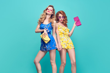 Wall Mural - Two Young Beautiful European girl Posing in Studio. Fashionable female Model, Wavy Hairstyle, Trendy Sunglasses. Sisters in Stylish Glamour Summer Outfit. Gorgeous Woman