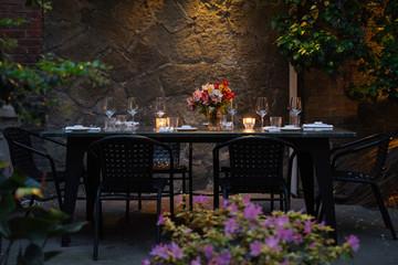 Elegantly set table at beautiful patio
