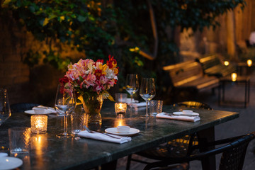 Elegantly set table at beautiful patio