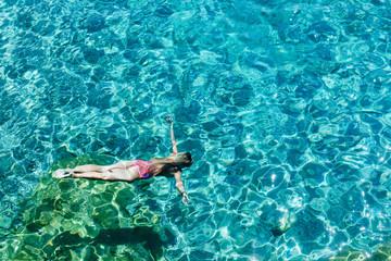 A Woman Swimming in Sea