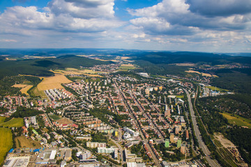 Landscape with big city in Czech republic - Brno from above surrounded by forests and hills