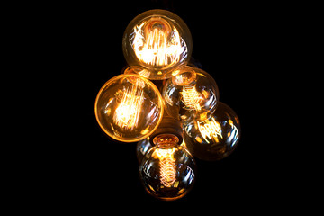 Electric lamps on a dark background.
