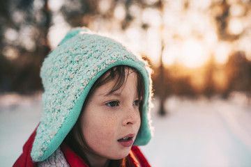 Portrait of a smiling girl standing in the snow