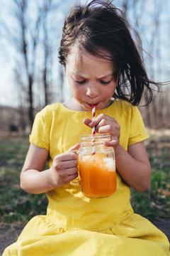 Girl enjoying a summer drink