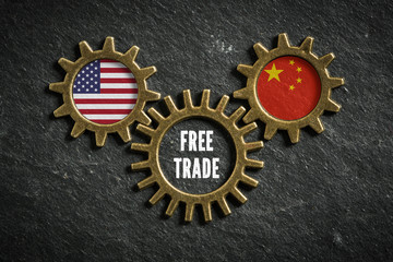 """Gears on slate background with the flags of USA and China in it, connected bei a gear with the words """"free trade"""" in it"""