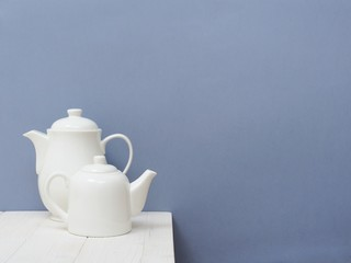 Pair White Teapots on the Table in the kitchen.Indoor Interior. Scandinavian style. Love Concept.