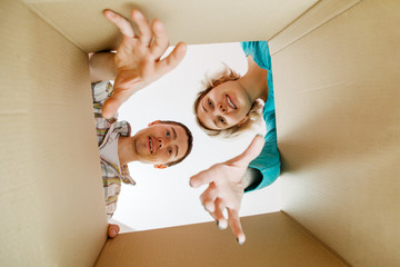 Image of man and woman peering into cardboard box